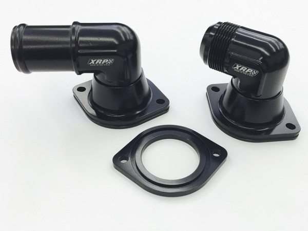 "New Swivel Water Necks for the Chevrolet LS motors. 1-1/4"", 1-1/2"" Slip fit and -16, -20 AN accepts new style thermostat with rubber seal. Spacer plate adapts new style thermostat housing to earlier LS blocks. Check out our other Swivel Necks for Small and Big blocks"