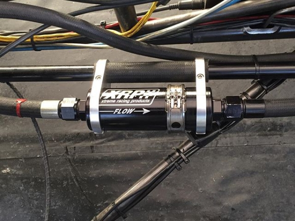 Clamshell Quick Release Inline Oil Filter from on the @jonnielindberg piloted racing Top Alcohol Funny Car. Note the clamshells are available in Super Nickel as well as standard purple. Oil or fuel use. Check it out at www.xrp.com